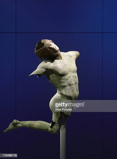 Closeup of Dancing Satyr on blue background Royal Academy Bronze Exhibition London United Kingdom Architect Stanton Williams 2012