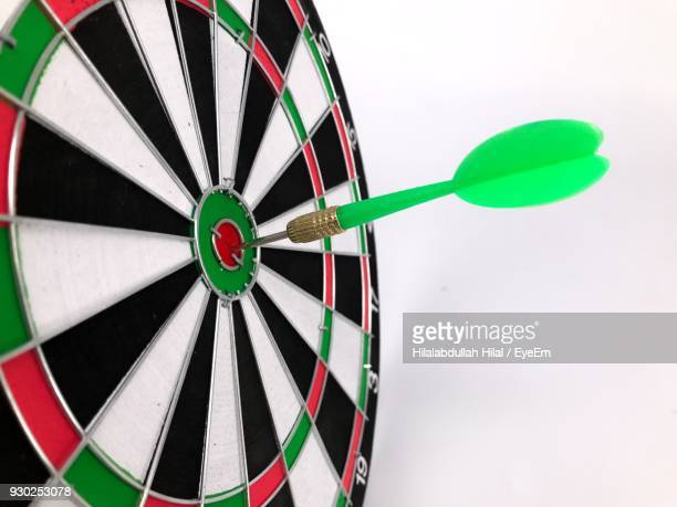 Close-Up Of Dart Against White Background