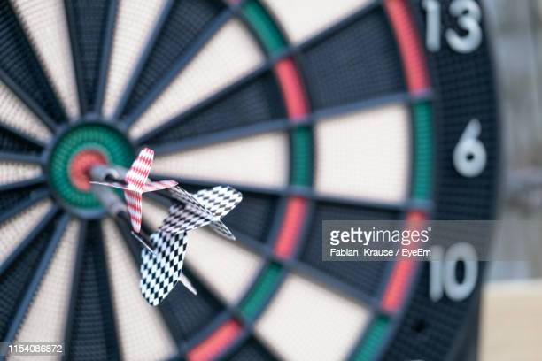 close-up of dart board - ziel stock-fotos und bilder