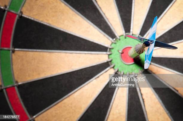 Close-up of dart hitting the bullseye