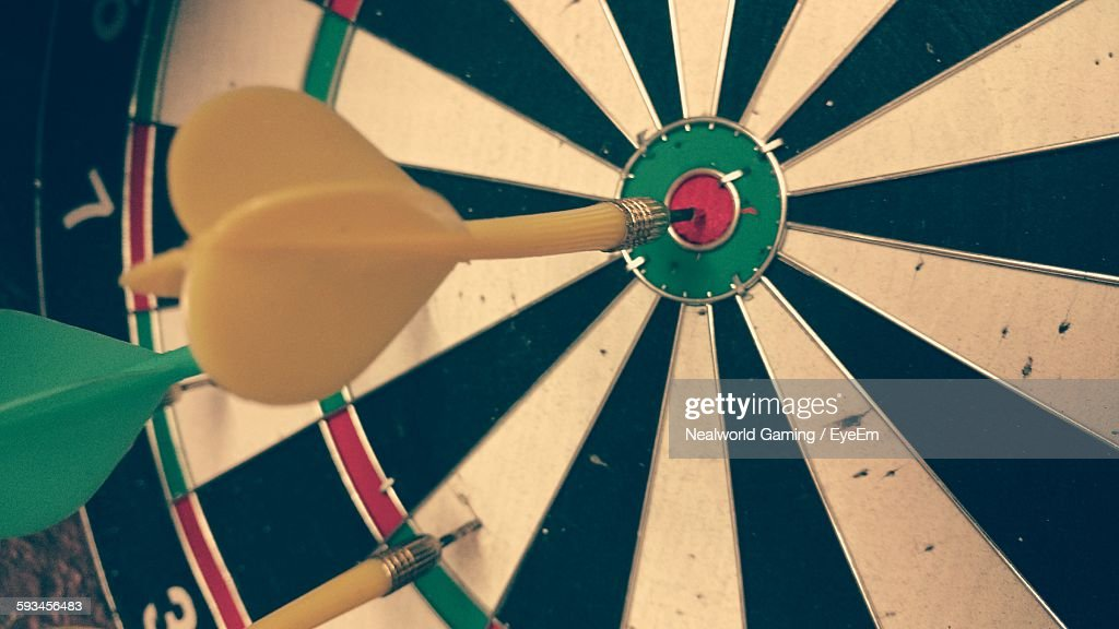 Close-Up Of Dart On Target : Stock Photo