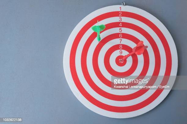 close-up of dartboard against gray background - sports target stock photos and pictures