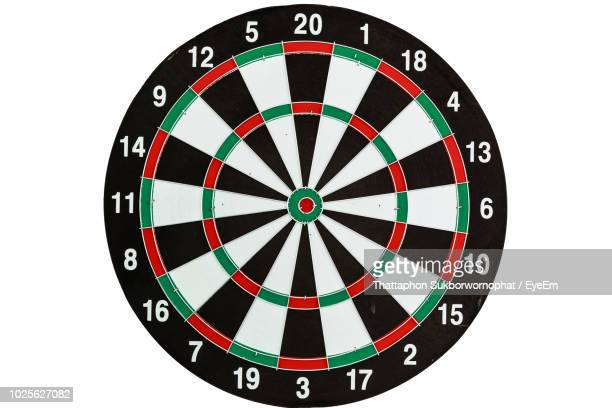 close-up of dartboard against white background - darts stock pictures, royalty-free photos & images