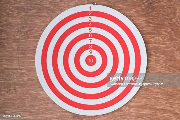close-up of dartboard on table - sports target stock photos and pictures