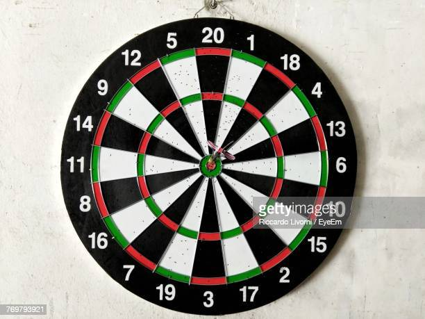 close-up of dartboard on wall - dartboard stock pictures, royalty-free photos & images