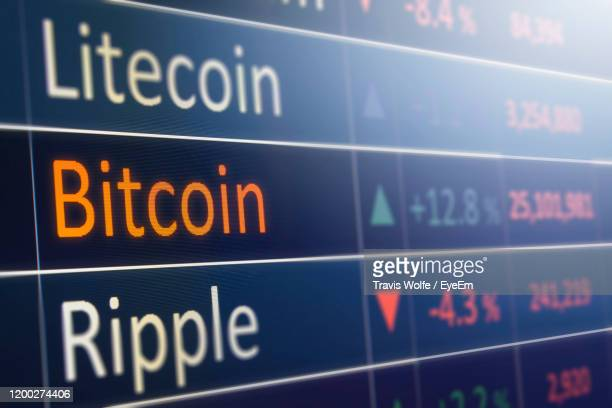 close-up of data on computer screen - bitcoin stock pictures, royalty-free photos & images