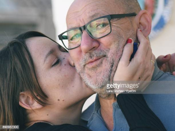 Close-Up Of Daughter Kissing Father