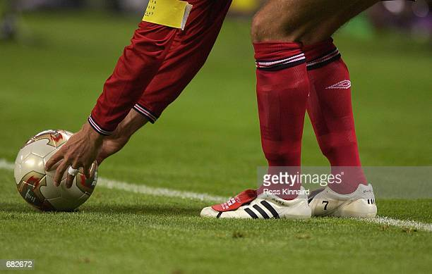 A closeup of David Beckham of England adidas boots as he prepares to take a freekick during the FIFA World Cup Finals 2002 Group F match between...