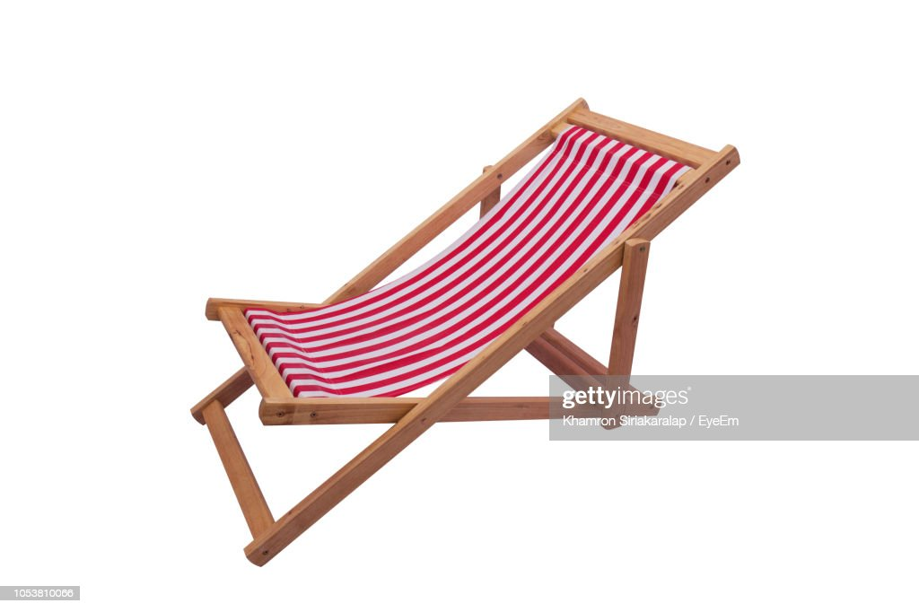 Close-Up Of Deck Chair Against White Background : Stock Photo