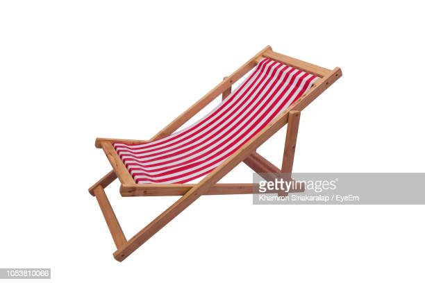 close-up of deck chair against white background - outdoor chair stock pictures, royalty-free photos & images