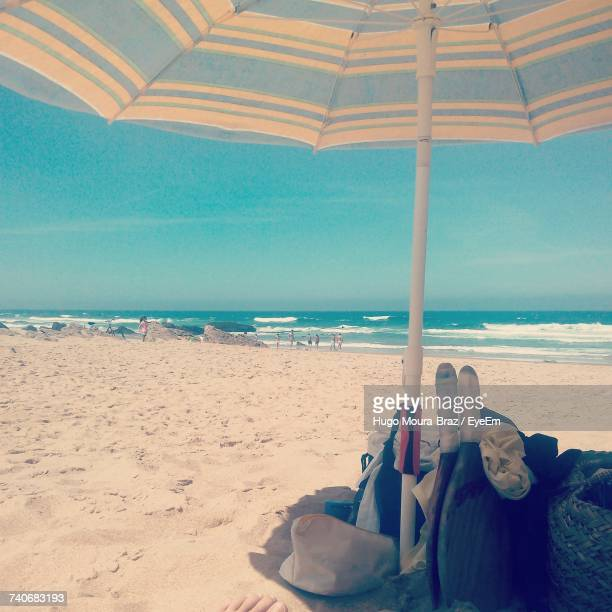 close-up of deck chairs on beach against clear sky - moura stock photos and pictures