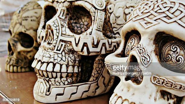 Close-Up Of Decorated Skulls On Market Stall For Sale
