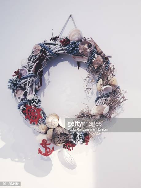 close-up of decoration hanging against wall - botoșani romania stock pictures, royalty-free photos & images