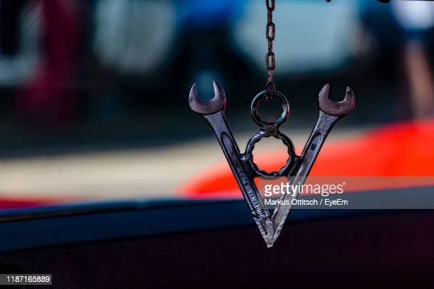 close-up of decoration hanging in car - pendant stock pictures, royalty-free photos & images