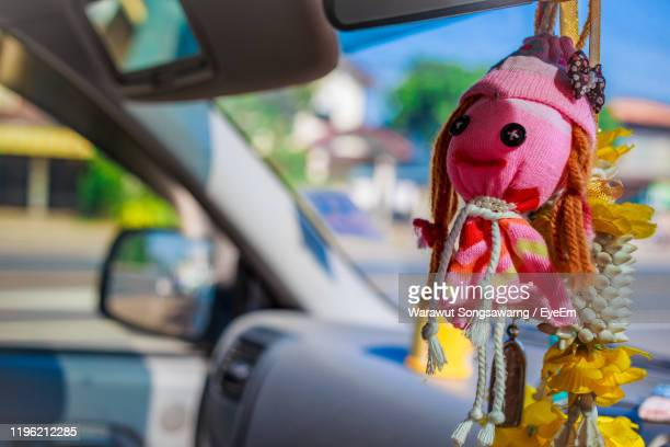 close-up of decoration hanging in car - car decoration stock pictures, royalty-free photos & images