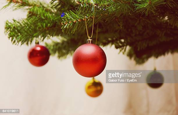 Close-Up Of Decoration On Christmas Tree At Home