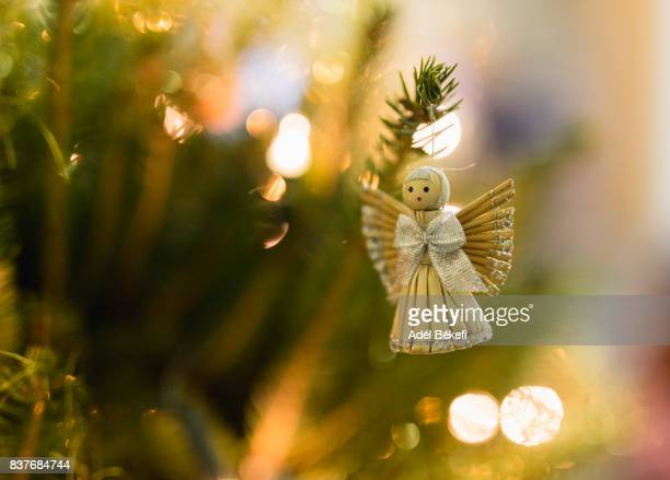 close-up of decoration on christmas tree at night - angel wings stock pictures, royalty-free photos & images