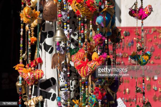 Close-Up Of Decorations For Sale At Street Market During Sunny Day