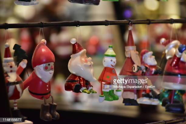 close-up of decorations hanging for sale in market - santa close up stock pictures, royalty-free photos & images