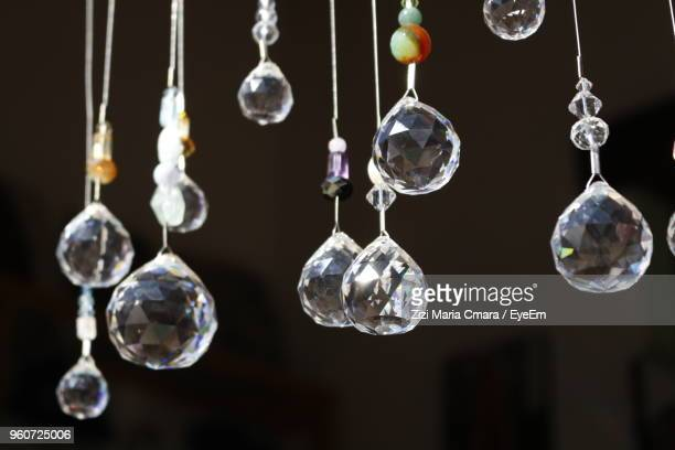 close-up of decorations hanging in room - crystal stock pictures, royalty-free photos & images