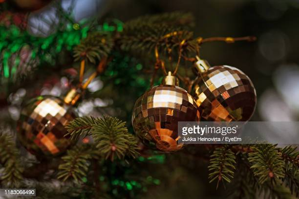 close-up of decorations hanging on christmas tree - heinovirta stock photos and pictures