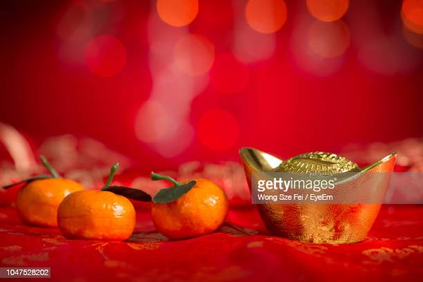 close-up of decorations on table for chinese new year - chinese new year stock pictures, royalty-free photos & images