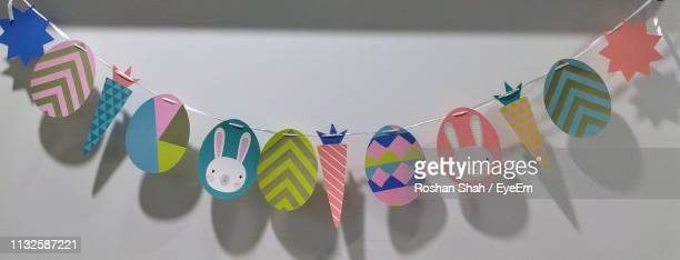 close-up of decorations on wall - easter decoration ストックフォトと画像