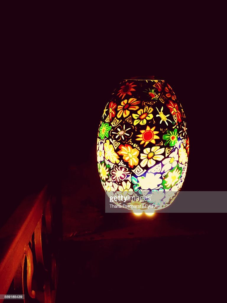 Closeup of decorative illuminated electric lamp on table stock close up of decorative illuminated electric lamp on table geotapseo Image collections