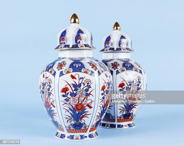 Close-Up Of Decorative Urns Against Blue Background
