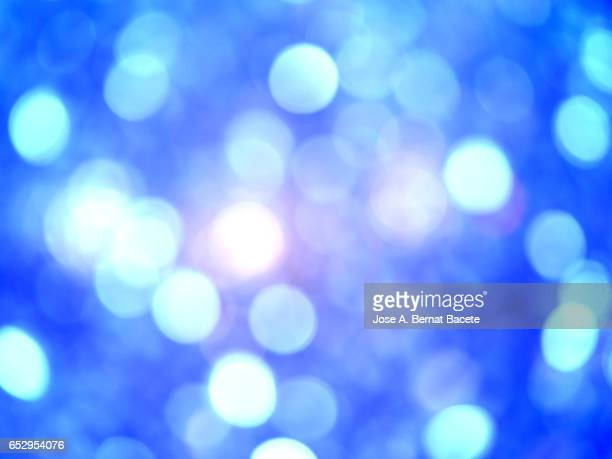 Close-Up Of Defocused Light in the shape of circles on a blue background