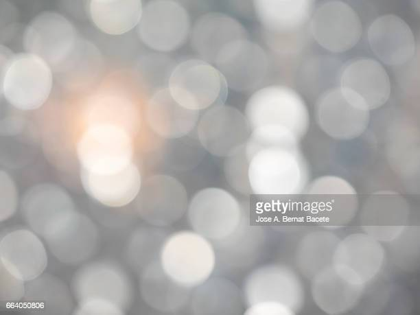 close-up of defocused light in the shape of circles - luz eléctrica stock pictures, royalty-free photos & images