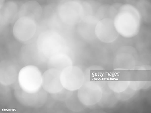 close-up of defocused light in the shape of circles - gray background stock pictures, royalty-free photos & images