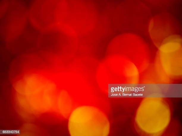 Close-Up Of Defocused Light in the shape of circles red color