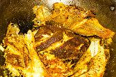 closeup delicious marinated frying fish pan