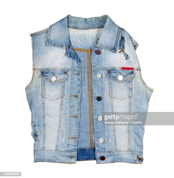 close-up of denim jacket against white background - sleeveless stock pictures, royalty-free photos & images