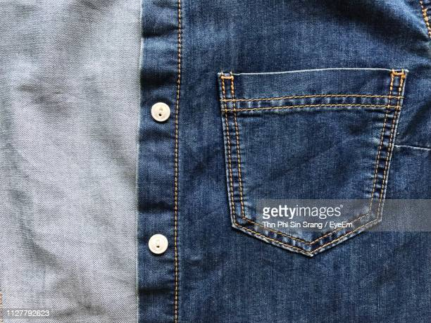 close-up of denim jacket - spijkerbroek stockfoto's en -beelden