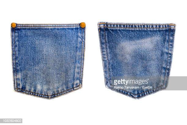 close-up of denim pockets against white background - pocket stock pictures, royalty-free photos & images