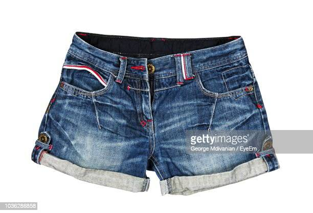 close-up of denim shorts against white background - denim shorts stock pictures, royalty-free photos & images