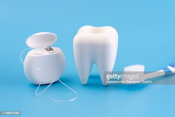 close-up of dental equipment against blue background - dental floss stock pictures, royalty-free photos & images