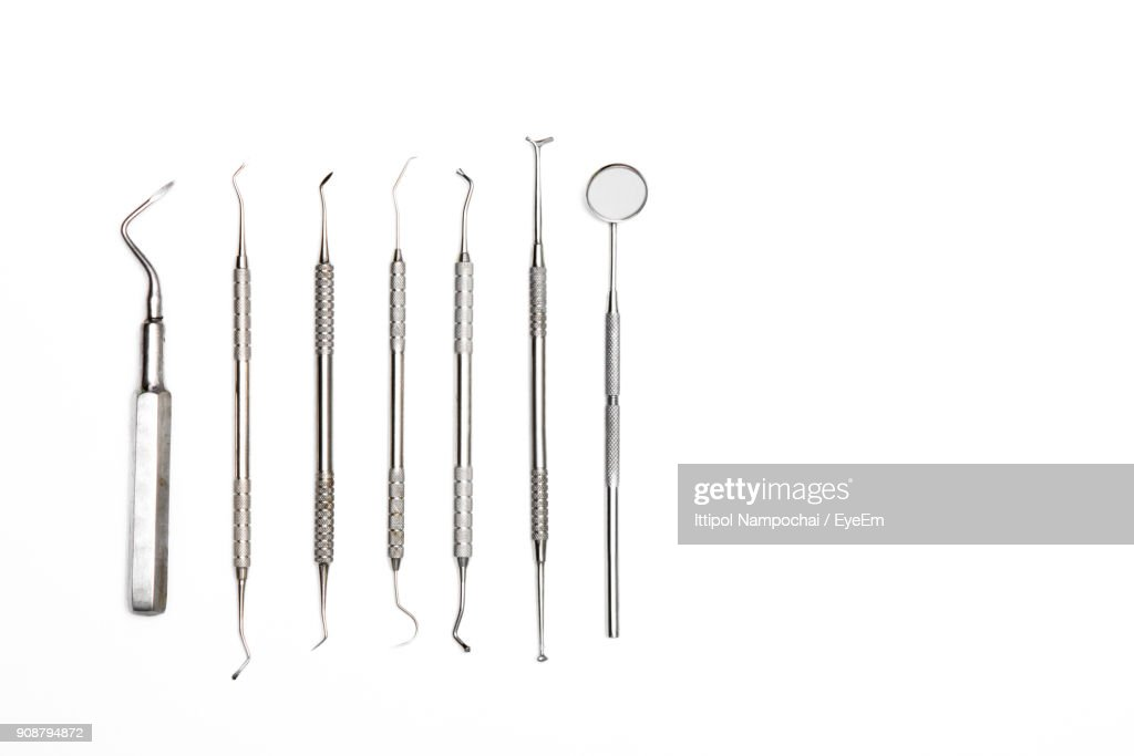 Closeup Of Dental Instruments Over White Background High-Res