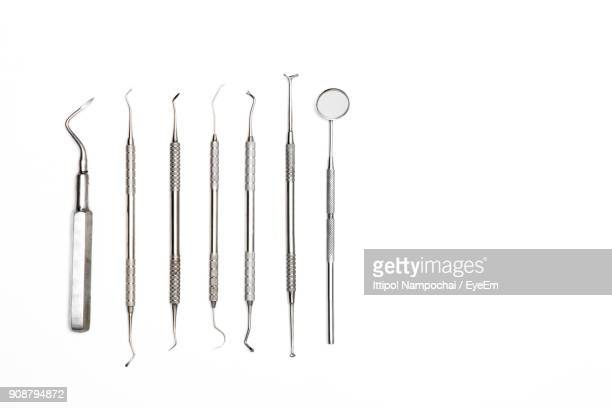 close-up of dental instruments over white background - dental equipment stock pictures, royalty-free photos & images