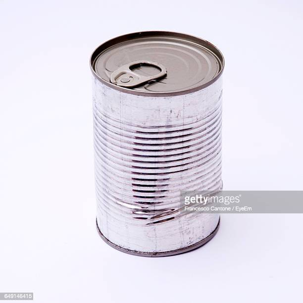 Close-Up Of Dented Can Against White Background