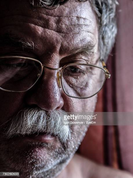 close-up of depressed mature man - igor golovniov stock pictures, royalty-free photos & images