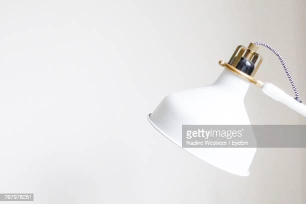 Close-Up Of Desk Lamp Against White Background