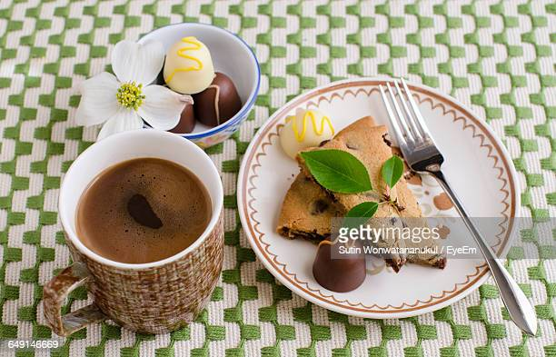 Close-Up Of Dessert And Coffee Served On Table