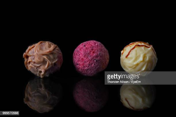 Close-Up Of Desserts Against Black Background