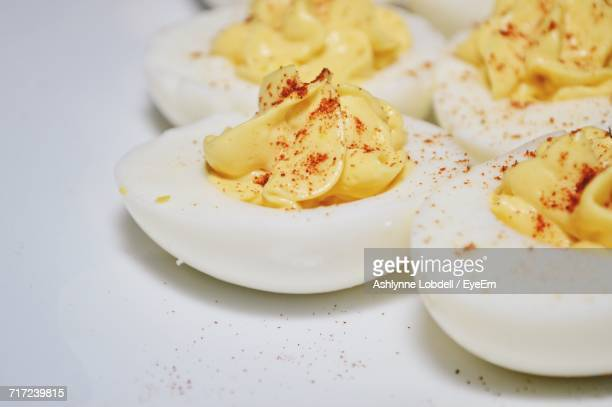 close-up of deviled eggs in plate - hard boiled eggs stock photos and pictures
