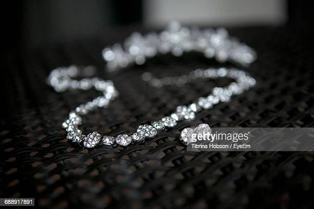 Close-Up Of Diamond Necklace And Earring On Table