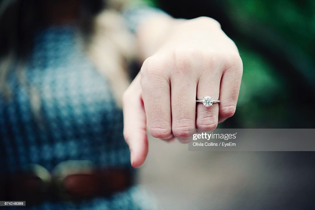 Close-Up Of Diamond Ring In Human Finger : Stock Photo