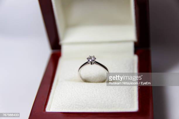 Close-Up Of Diamond Ring In Jewelry Box On Table